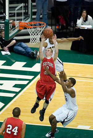 Record-Eagle/Jan-Michael Stump<br /> Suttons Bay's Shane Kaufman (3) shoots a layup over Melvindale ABT's Yakimi Noble (15) in the Class C state championship game Saturday at the Breslin Center in East Lansing.