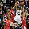 Record-Eagle/Jan-Michael Stump<br /> Suttons Bay's Dwuan Anderson (22) blocks the shot of Melvindale ABT's Yakimi Noble (15) in the Class C state championship game Saturday at the Breslin Center in East Lansing.