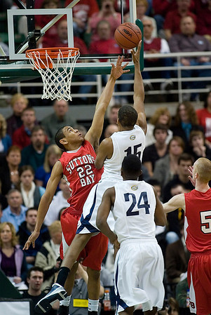 Record-Eagle/Jan-Michael Stump<br /> Suttons Bay's Dwuan Anderson (22) tries to block the shot of Melvindale ABT's Yakimi Noble (15) in the Class C state championship game Saturday at the Breslin Center in East Lansing.