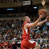Record-Eagle/Jan-Michael Stump<br /> Suttons Bay's Noah Reyhl (23) drives for a layup agaisnt Melvindale ABT in the Class C state championship game Saturday at the Breslin Center in East Lansing.