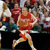 Record-Eagle/Jan-Michael Stump<br /> Suttons Bay's Noah Reyhl (23) pushes the ball upcourt against Melvindale ABT in the Class C state championship game Saturday at the Breslin Center in East Lansing.