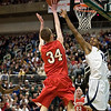 Record-Eagle/Jan-Michael Stump<br /> Suttons Bay's Chase Palmer (34) shoots over Melvindale ABT's Yakimi Noble (15) in the Class C state championship game Saturday at the Breslin Center in East Lansing.