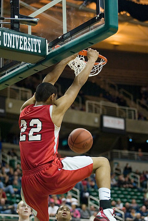 Record-Eagle/Jan-Michael Stump<br /> Suttons Bay's Dwuan Anderson (22) dunks on Melvindale ABT in the Class C state championship game Saturday at the Breslin Center in East Lansing.