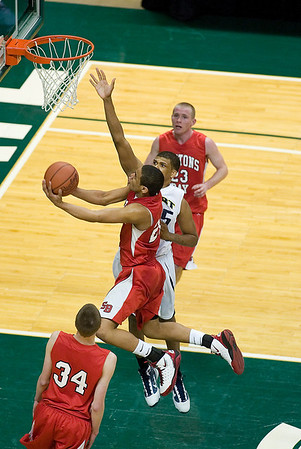 Record-Eagle/Jan-Michael Stump<br /> Suttons Bay's Dwuan Anderson (22) drives for a layup past Melvindale ABT's Yakimi Noble (15) in the Class C state championship game Saturday at the Breslin Center in East Lansing.