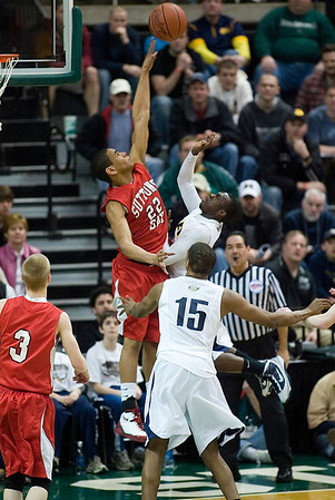 Record-Eagle/Jan-Michael Stump<br /> Suttons Bay's Dwuan Anderson (22) blocks the shot of Melvindale ABT's Marcel Smith (2) in the Class C state championship game Saturday at the Breslin Center in East Lansing.