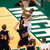 Record-Eagle/Jan-Michael Stump<br /> Suttons Bay's Dwuan Anderson (22) shoots over Bridgman's Connor Magro (32) and Cameron Reeves (24) in the state semifinal game Thursday at the Breslin Center in East Lansing.