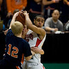 Record-Eagle/Jan-Michael Stump<br /> Bridgman's Mark Haukereid (12) tries to trap Suttons Bay's Dwuan Anderson (22) in the state semifinal game Thursday at the Breslin Center in East Lansing.
