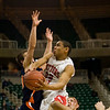 Record-Eagle/Jan-Michael Stump<br /> Suttons Bay's Dwuan Anderson (22) drives past and is fouled by Bridgman's Michael Kamp (30) in the state semifinal game Thursday at the Breslin Center in East Lansing.