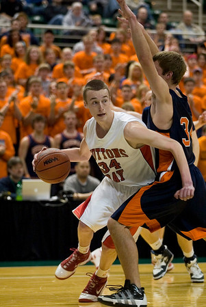 Record-Eagle/Jan-Michael Stump<br /> Suttons Bay'S Chase Palmer (34) drives the baseline past Bridgman's Parker Mojsiejenko (34) in the first quarter of the state semifinal game Thursday at the Breslin Center in East Lansing.