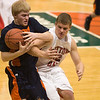 Record-Eagle/Jan-Michael Stump<br /> Suttons Bay's Jared Orban (32) and Bridgman's Mark Haukereid (12) fight for a loose ball in the state semifinal game Thursday at the Breslin Center in East Lansing.