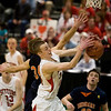 Record-Eagle/Jan-Michael Stump<br /> Suttons Bay's Chase Palmer (34) fights for a rebound with Bridgman's Parker Mojsiejenko (24) in the state semifinal game Thursday at the Breslin Center in East Lansing.