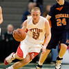 Record-Eagle/Jan-Michael Stump<br /> Suttons Bay's Noah Reyhl (23) drives the ball upcourt against Bridgman in the state semifinal game Thursday at the Breslin Center in East Lansing.