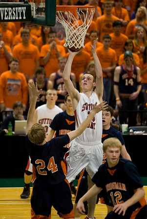Record-Eagle/Jan-Michael Stump<br /> Suttons Bay's Stephen Wheelock (33) shoots over Bridgman's Cameron Reeves (24) in the state semifinal game Thursday at the Breslin Center in East Lansing.