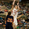 Record-Eagle/Jan-Michael Stump<br /> Suttons Bay's Chase Palmer (34) shoots over Bridgman's Zane Copeland (20) in the state semifinal game Thursday at the Breslin Center in East Lansing.