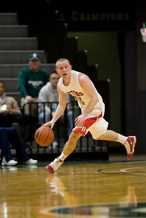 Record-Eagle/Jan-Michael Stump<br /> Suttons Bay's Noah Reyhl (23) pushes the ball upcourt agianst Bridgman in the state semifinal game Thursday at the Breslin Center in East Lansing.
