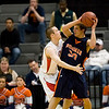 Record-Eagle/Jan-Michael Stump<br /> Suttons Bay's Stephen Wheelock (33) defends Bridgman's Michael Kamp (30) in the state semifinal game Thursday at the Breslin Center in East Lansing.