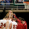 Record-Eagle/Jan-Michael Stump<br /> Suttons Bay huddles before the start of their game agaisnt Bridgman in the state semifinal game Thursday at the Breslin Center in East Lansing.