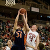 Record-Eagle/Jan-Michael Stump<br /> Suttons Bay's Noah Reyhl (23) and Bridgman's Parker Mojsiejenko (34) fight for a rebound in the state semifinal game Thursday at the Breslin Center in East Lansing.