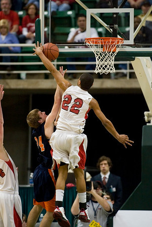 Record-Eagle/Jan-Michael Stump<br /> Suttons Bay's Dwuan Anderson (22) blocks the shot of Bridgman's Parker Mojsiejenko (34) in the state semifinal game Thursday at the Breslin Center in East Lansing.