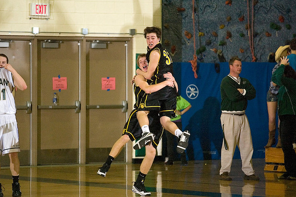 Record-Eagle/Jan-Michael Stump<br /> Traverse City Central's Mack Sovereign (32) leaps into the arms of Erik Krueger (22) after Krueger's game winning shot Friday at Traverse City West.