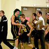 Record-Eagle/Jan-Michael Stump<br /> Traverse City Central's Erik Krueger (22) is mobbed my teammates after his game-winning shot Friday at Traverse City West