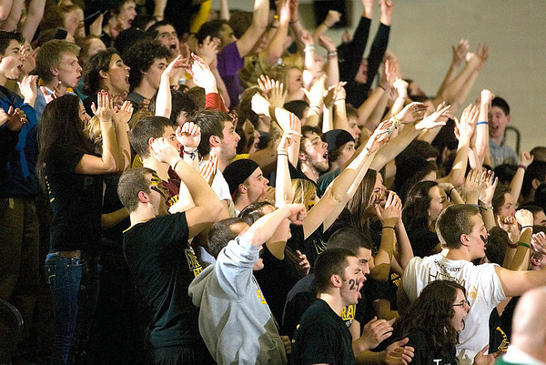 Record-Eagle/Jan-Michael Stump<br /> Traverse City Central fans cheer for the Trojans near the end of Friday's win at Traverse City West