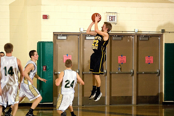 Record-Eagle/Jan-Michael Stump<br /> Traverse City Central's Erik Krueger (22) shoots the game-winning shot in Friday's 53-50 win at Traverse City West