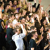 Record-Eagle/Jan-Michael Stump<br /> Traverse City Central fans cheer for the Trojans during Friday's game at Traverse City West.