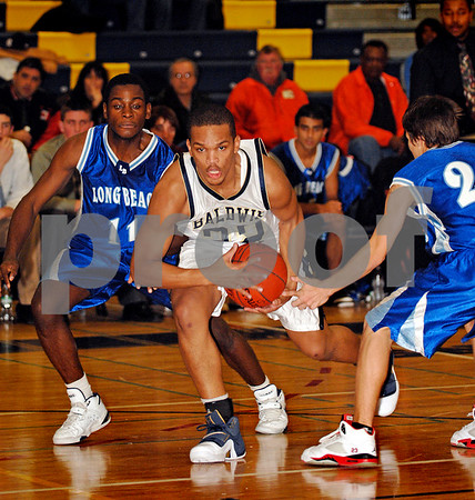 #32 Ethan Jones, BHS, #11 Darrell Evans, LBHS ,Long Beach HS. Baldwin HS vs Long Beach, Boys Basketball, December 12th, 2007 at Baldwin. 85-49. Photo by Kathy Leistner