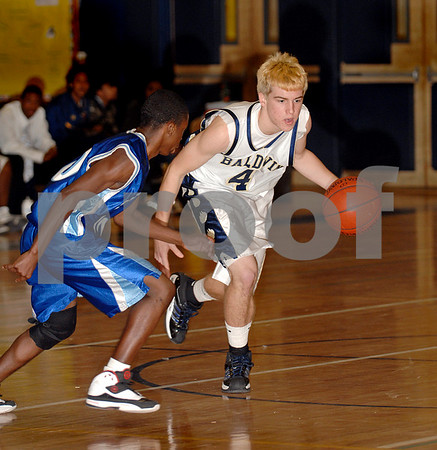 #10 Taequann Washington #4 Joe Ednie BHS ,Long Beach HS. Baldwin HS vs Long Beach, Boys Basketball, December 12th, 2007 at Baldwin. 85-49. Photo by Kathy Leistner