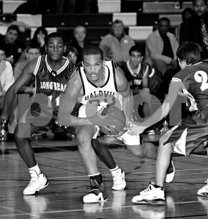 #22 Anthony Lee, BHS, #11 Darrell Evans, LBHS ,Long Beach HS. Baldwin HS vs Long Beach, Boys Basketball, December 12th, 2007 at Baldwin. 85-49. Photo by Kathy Leistner