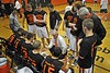 Coach Joe Lores speaks to his team. Dec. 19th, 2009. Photo by Kathy Leistner
