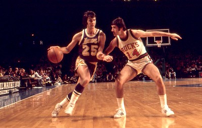 Lakers Gail Goodrich drives on Jon McGlocklin
