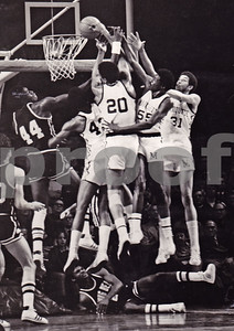 Hitting the boards.  Marquette Warriors, 1974 NCAA Tournament runner-up.  All four players drafted into NBA/ABA:  #43 Earl Tatum (Lakers), #20 Maurice Lucas (St Louis Spirits of ABA), #55 Marcus Washington (Houston Rockets), and #31 Bo Ellis (Washington Bullets).