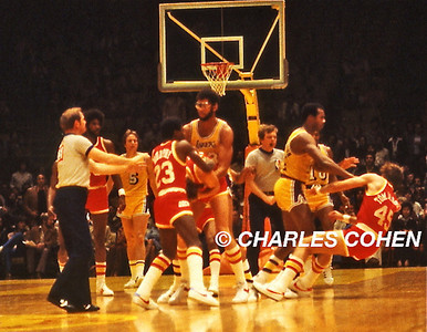 The Infamous Punch...Los Angeles Lakers Kermit Washington punches the Houston Rockets Rudy Tomjanovich in LA Forum on Dec.9, 1977.  Abdul-Jabbar holds onto a Houston Rocket who's bent over and holding his face as #23 Calvin Murphy attempts to calm them down.