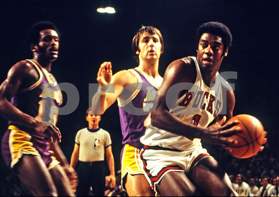 The Big O, Oscar Robertson, guarded by Gail Goodrich and Mark Price.  1972, Milwaukee Arena.