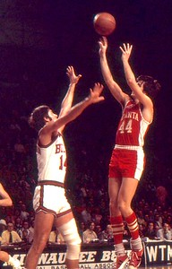 Pete Maravich fires shot over Jon McGlocklin