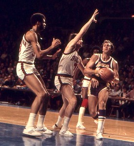 Legendary Laker Jerry West drives past Bucks Abdul-Jabbar
