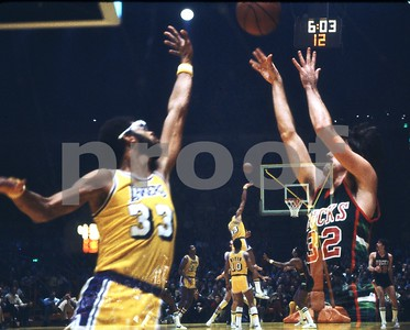 In Camera Double Exposure of Bucks Brian Winters shooting J over Jabbar and Jabbar hooking over Bucks, LA Forum
