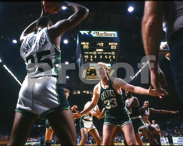Larry Bird guards Paul Pressey during NBA East Finals playoff game