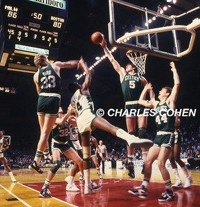 Celtics Bill Walton and Larry Bird double block the Milwaukee Bucks Sidney Moncreif as #44 Danny Ainge looks on.  Danny Ainge is now the Celtics General Manager.  This shot taken during a playoff game.