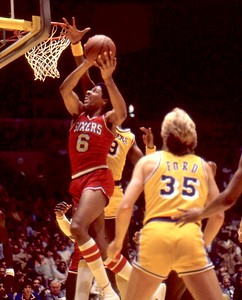 Dr J going up for the dunk as Jim Chones attempts block