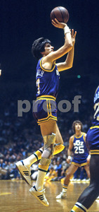 Pistol Pete Maravich puts up a shot vs Lakers as #25 Gail Goodrich looks on
