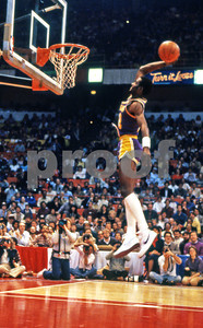 Lakers Michael Cooper dunks in Denver.
