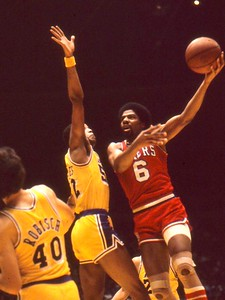 Dr J drives on Jamal Wilkes and puts up lefty hook