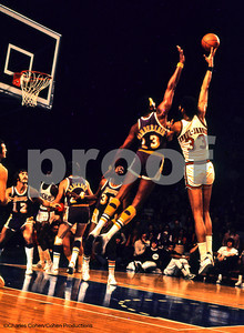 I took this photo in 1972, in Milwaukee.  The Classic Confrontation, Wilt vs Kareem, the two greatest scorers in NBA History.  That's Pat Riley #12 under the hoop and on the left edge is Jerry West's profile.  This was Wilt's last season in the NBA.  The camera I took this with, my Minolta, was a single shot camera, I did not have a motor drive.