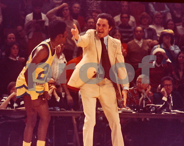 """Give Em Hell Al!"" was a rallying cry during Al Maguires reign at Marquette. The Great Al Maguire working the refs during a 1974 Marquette Warriors game in the MECCA of Milwaukee.  His point guard Lloyd Walton watching Al.  His team that year was runnerup in NCAA Tournament, finishing season 26-5."