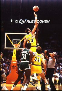 Lakers Abdul-Jabbar controls the tip vs Celtics Robert Parrish as Cornbread Maxwell and Kurt Rambis jockey for position to begin NBA Finals.