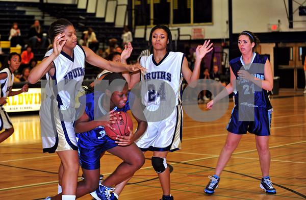 #35 Woodlynn Daniel, OSHS, #21 Lauren Schlitt, OSHS, #1 Kalin Russell, #24 Shayna Gatling, BHSH. Oside HS vs Baldwin HS. Jan. 21st, 2010. Photo by Kathy Leistner