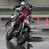 Riders 990, Devin Arthur,and 39, Peter Bace are first around turn 1 in the morning practice rounds.